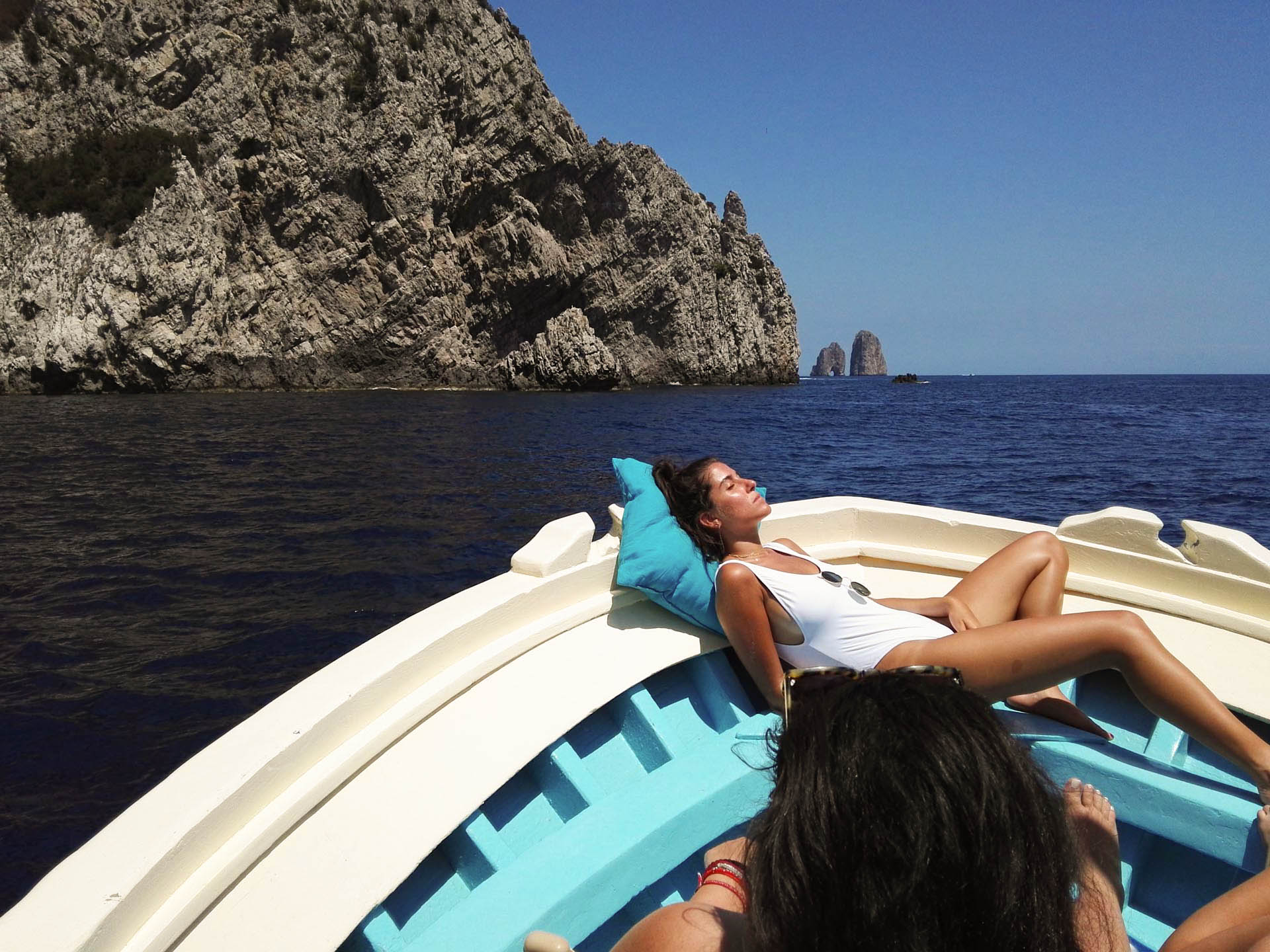 Sunbathing on the boat near Capri