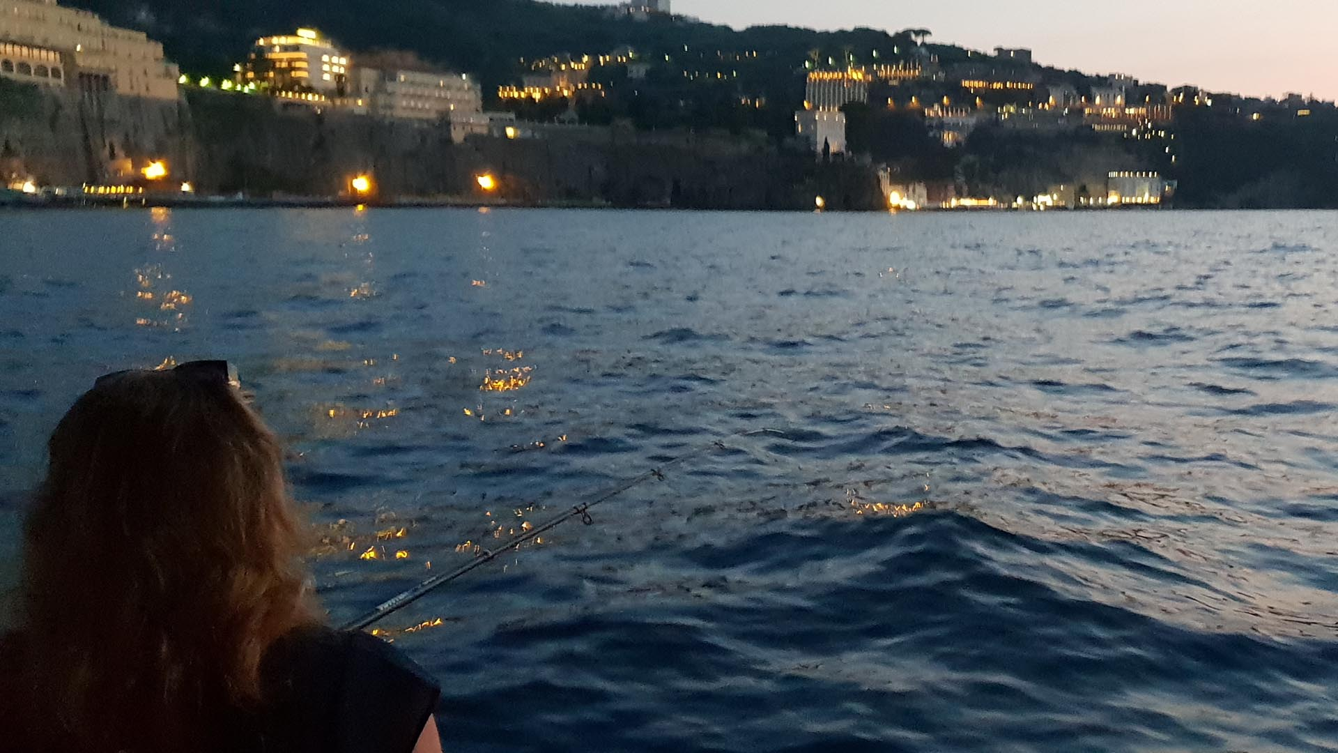 Fishing at night from the boat in front of Sorrento